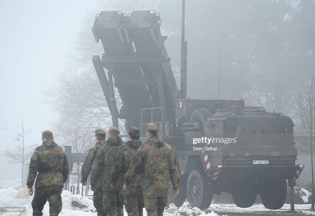 Members of the German Bundeswehr walk past a Patriot launching system during a press day at the Luftwaffe Warbelow training center on December 18, 2012 in Warbelow, Germany. Germany, along with the USA and the Netherlands, will send two Patriot systems to Turkey in January to protect Turkey from Syrian attacks.