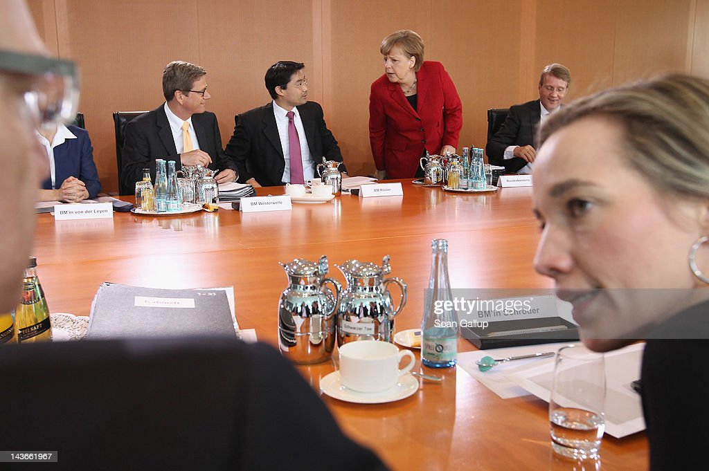Members of the German government cabinet, including Chancellor <a gi-track='captionPersonalityLinkClicked' href=/galleries/search?phrase=Angela+Merkel&family=editorial&specificpeople=202161 ng-click='$event.stopPropagation()'>Angela Merkel</a> (in red), attend the weekly cabinet meeting on May 2, 2012 in Berlin, Germany. Among topics on the morning's agenda was a the creation of a government supervisory body to oversee prices gasoline retailers charge motorists at petrol staitons.