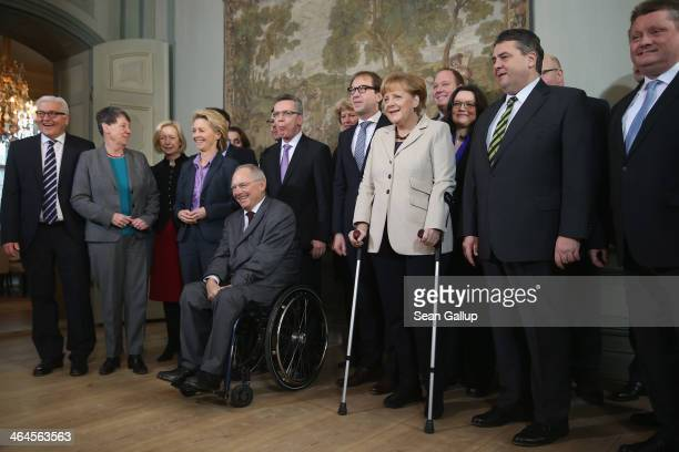 Members of the German government cabinet including Chancellor Angela Merkel walking with crutches due to a crosscountry skiing injury Vice Chancellor...