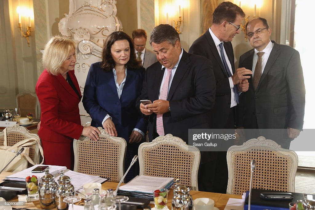 Members of the German government cabinet, including (from L to R) Education Minister Johanna Wanka, Minister of Work and Social Issues Andrea Nahles, Vice Chancellor and Economy and Energy Minister Sigmar Gabriel, Development Minister Gerd Mueller and Agriculture and Consumer Protection Minister Christian Schmidt attend at a meeting of the government cabinet at Schloss Meseberg palace on May 24, 2016 in Gransee, Germany. The government cabinet is meeting at Schloss Meseberg for a two-day retreat.