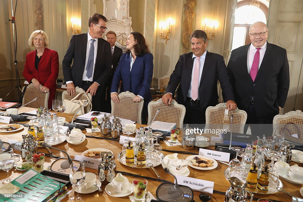 Members of the German government cabinet, including (from L to R) Education Minister <a gi-track='captionPersonalityLinkClicked' href=/galleries/search?phrase=Johanna+Wanka&family=editorial&specificpeople=5626570 ng-click='$event.stopPropagation()'>Johanna Wanka</a>, Development Minister Gerd Mueller, Minister of Work and Social Issues <a gi-track='captionPersonalityLinkClicked' href=/galleries/search?phrase=Andrea+Nahles&family=editorial&specificpeople=822618 ng-click='$event.stopPropagation()'>Andrea Nahles</a>, Vice Chancellor and Economy and Energy Minister <a gi-track='captionPersonalityLinkClicked' href=/galleries/search?phrase=Sigmar+Gabriel&family=editorial&specificpeople=543927 ng-click='$event.stopPropagation()'>Sigmar Gabriel</a> and Minister of the Chancellery Peter Altmeier attend a meeting of the government cabinet at Schloss Meseberg palace on May 24, 2016 in Gransee, Germany. The government cabinet is meeting at Schloss Meseberg for a two-day retreat.