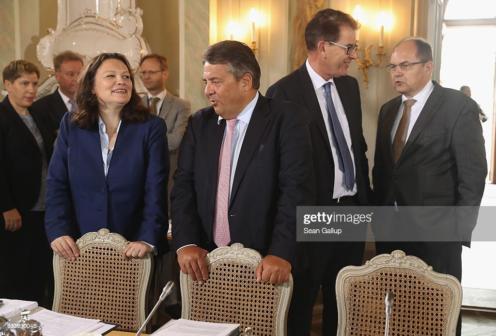 Members of the German government cabinet, including (from L to R) Minister of Work and Social Issues <a gi-track='captionPersonalityLinkClicked' href=/galleries/search?phrase=Andrea+Nahles&family=editorial&specificpeople=822618 ng-click='$event.stopPropagation()'>Andrea Nahles</a>, Vice Chancellor and Economy and Energy Minister <a gi-track='captionPersonalityLinkClicked' href=/galleries/search?phrase=Sigmar+Gabriel&family=editorial&specificpeople=543927 ng-click='$event.stopPropagation()'>Sigmar Gabriel</a>, Development Minister Gerd Mueller and Agriculture and Consumer Protection Minister Christian Schmidt attend at a meeting of the government cabinet at Schloss Meseberg palace on May 24, 2016 in Gransee, Germany. The government cabinet is meeting at Schloss Meseberg for a two-day retreat.