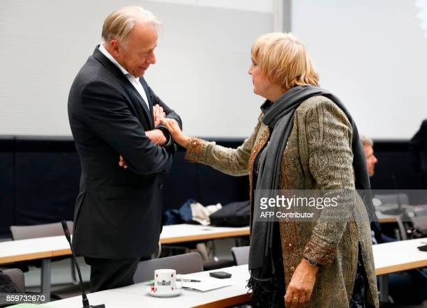 Members of the German Greens Party 'BÜNDNIS 90/DIE GRÜNEN' Claudia Roth and Juergen Trittin talk ahead of a meeting to constitute the Green Party's...