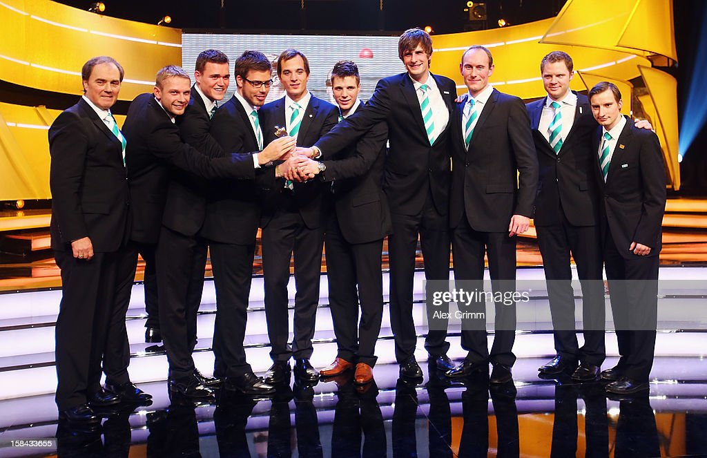 Members of the German men's eight rowing team pose after being awarded 'Athlete of the Year 2012' in the team category during a gala at the Kurhaus Baden-Baden on December 16, 2012 in Baden-Baden, Germany.
