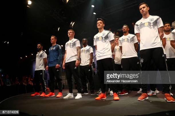 Members of the German national football team gather on the stage at the presentation of the 2018 FIFA World Cup Russia Adidas jersey at The Base on...