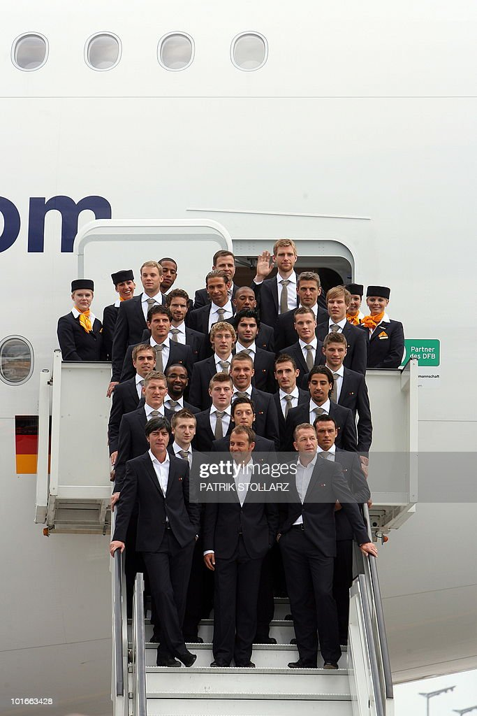 Members of the German national football team with (front row, L-R) head coach Joachim Loew, assistant coach Hans-Dieter Flick and the goalkeepers' trainer Andreas Koepke pose in front of an Airbus A380 of German airline Lufthansa before leaving for the FIFA Football World Cup 2010 in South Africa on June 6, 2010 at the airport in Frankfurt/M., western Germany. South Africa hosts the 2010 World Cup from June 11 to July 11.