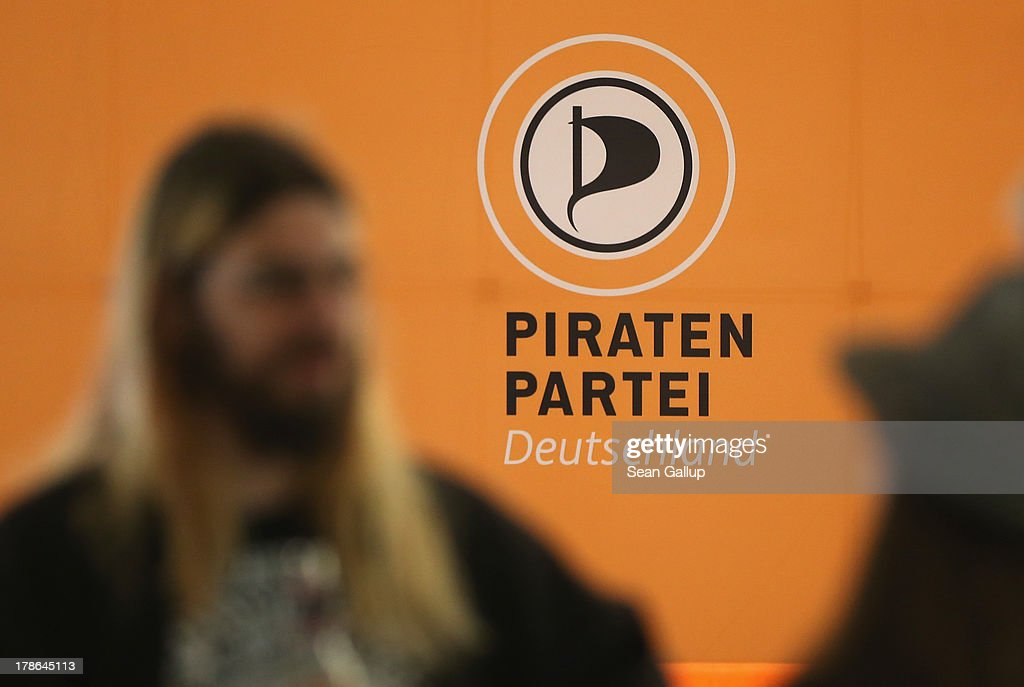 Members of the German Pirates Party (Die Piraten) chat at party regional election campaign headquarters on August 30, 2013 in Berlin, Germany. Germany is scheduled to hold elections on September 22 and the Pirates, who last year rode a wave of popularity that won them seats in several state parliaments, have since faltered and are unlikely to win the 5% minimum needed to gain seats in the Bundestag.