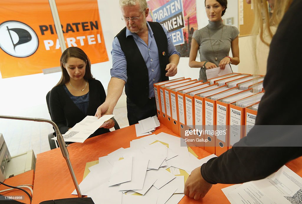 Members of the German Pirates Party (Die Piraten), including party leader Katharina Nocun (L), prepare a class action suit they are leading on behalf of over 6000 people to change a law that allows German law enforcement agencies to tap into electronic communications (Bestandsdatenauskunft) on August 30, 2013 in Berlin, Germany. The Pirates party are leading the suit in part due to public reaction over the current NSA surveillance scandal. Germany is scheduled to hold elections on September 22 and the Pirates, who last year rode a wave of popularity that won them seats in several state parliaments, have since faltered and are unlikely to win the 5% minimum needed to gain seats in the Bundestag.