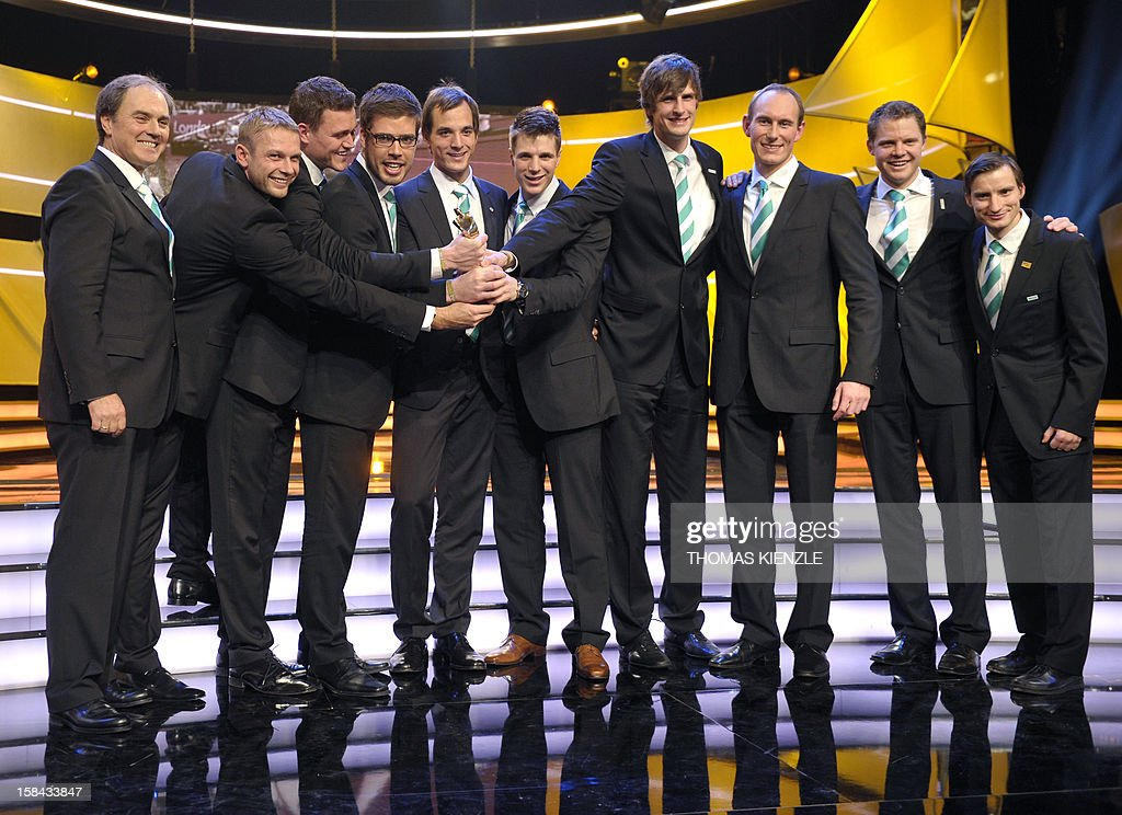 Members of the German rowing eight team hold the trophy after being awarded Germany's Team of the Year 2012 in Baden-Baden, southwestern Germany, on December 16, 2012.