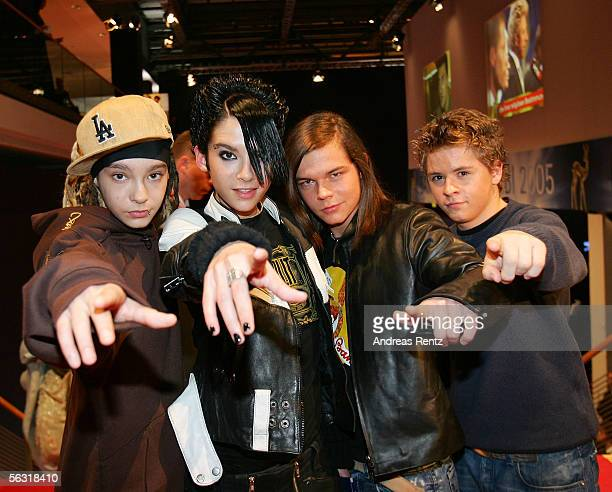 Members of the German teen band 'Tokio Hotel' gesture as they arrive for the 57th annual Bambi Awards at the International Congress Center December...