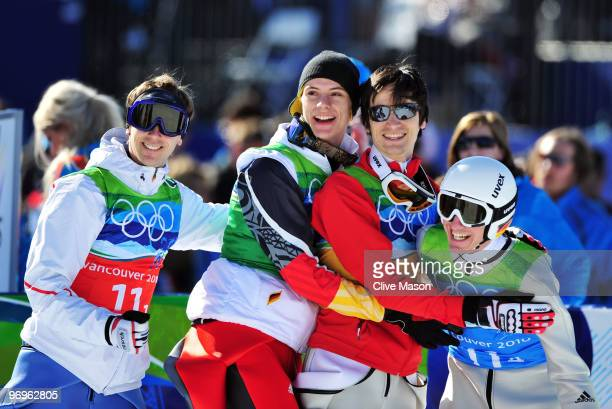 Members of the Germany ski jumping team celebrate their silver medal in the men's ski jumping team event on day 11 of the 2010 Vancouver Winter...