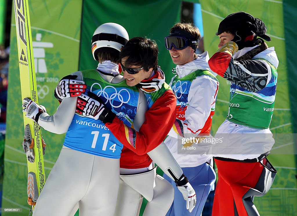 Members of the Germany ski jumping team celebrate their silver medal in the men's ski jumping team event on day 11 of the 2010 Vancouver Winter Olympics at Whistler Olympic Park Ski Jumping Stadium on February 22, 2010 in Whistler, Canada.