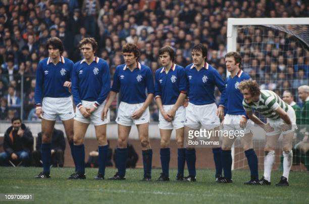 Members of the Glasgow Rangers team form a wall during a match against Celtic circa 1979 Left to right Gordon Smith Alex Miller Sandy Jardine Bobby...