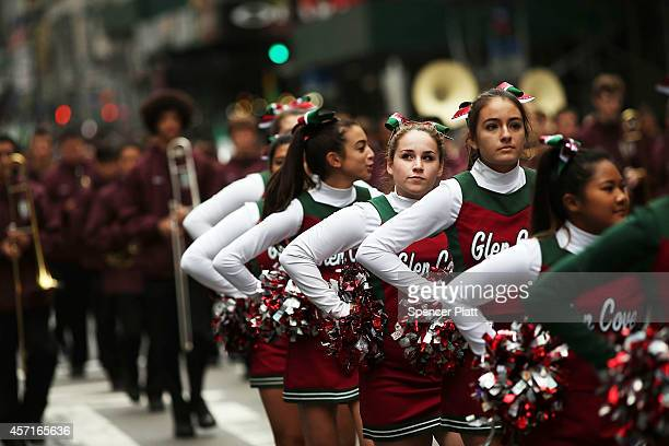 Members of the Glen Cove Cheerleading Squad on October 13 2014 in New York City Organized by the Columbus Citizens Foundation the parade is billed as...