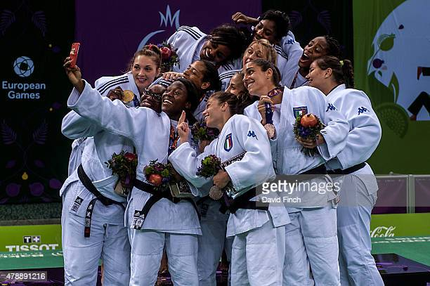 Members of the gold medal winning French Women's team and the Italian bronze medallists pose for a 'Selfie' after the Team Medal Ceremony during day...