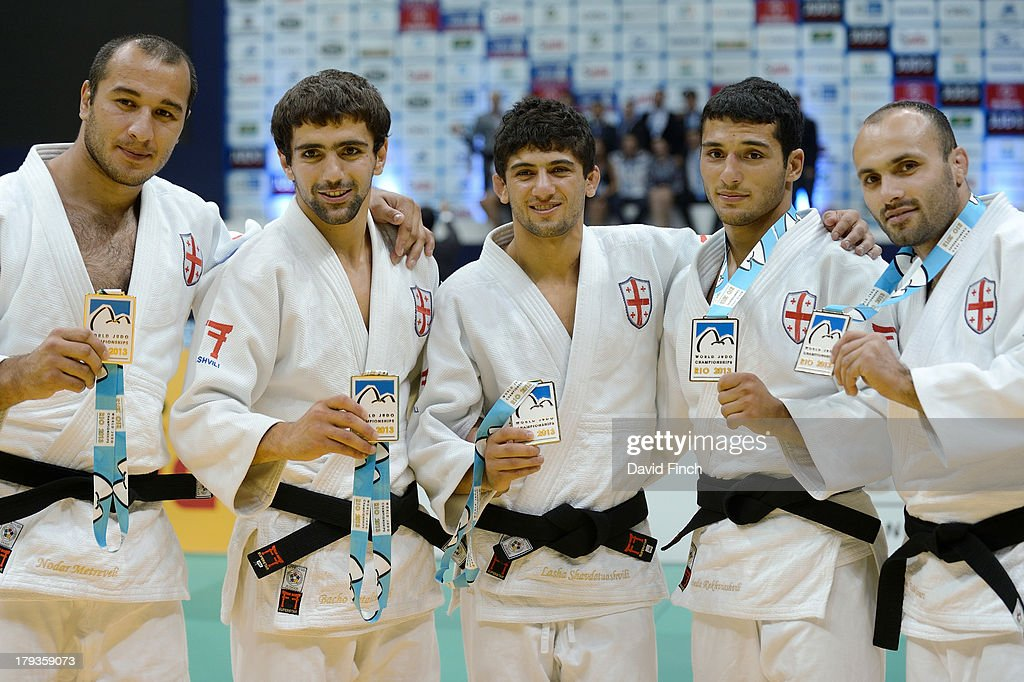 Members of the gold medal winning Georgian Team (L-R) <a gi-track='captionPersonalityLinkClicked' href=/galleries/search?phrase=Levan+Zhorzholiani&family=editorial&specificpeople=5490766 ng-click='$event.stopPropagation()'>Levan Zhorzholiani</a>, Nugzari Tatalashvili, Zebeda Rekhviashvili, <a gi-track='captionPersonalityLinkClicked' href=/galleries/search?phrase=Lasha+Shavdatuashvili&family=editorial&specificpeople=9163253 ng-click='$event.stopPropagation()'>Lasha Shavdatuashvili</a> and Levan Tsiklauri after the medal ceremony at the Rio World Judo Team Championships on Day 7 on September 01, 2013 at the Gympasium Maracanazinho in Rio de Janeiro, Brazil.