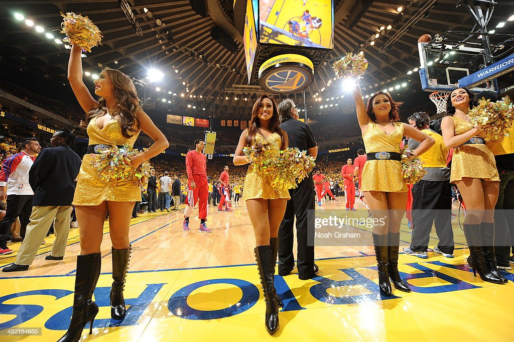Members of the Golden State Warriors cheerleading team perform for the crowd in Game Four of the Western Conference Quarterfinals between the Los Angeles Clippers and the Golden State Warriors at Oracle Arena on April 27, 2014 in Oakland, California.