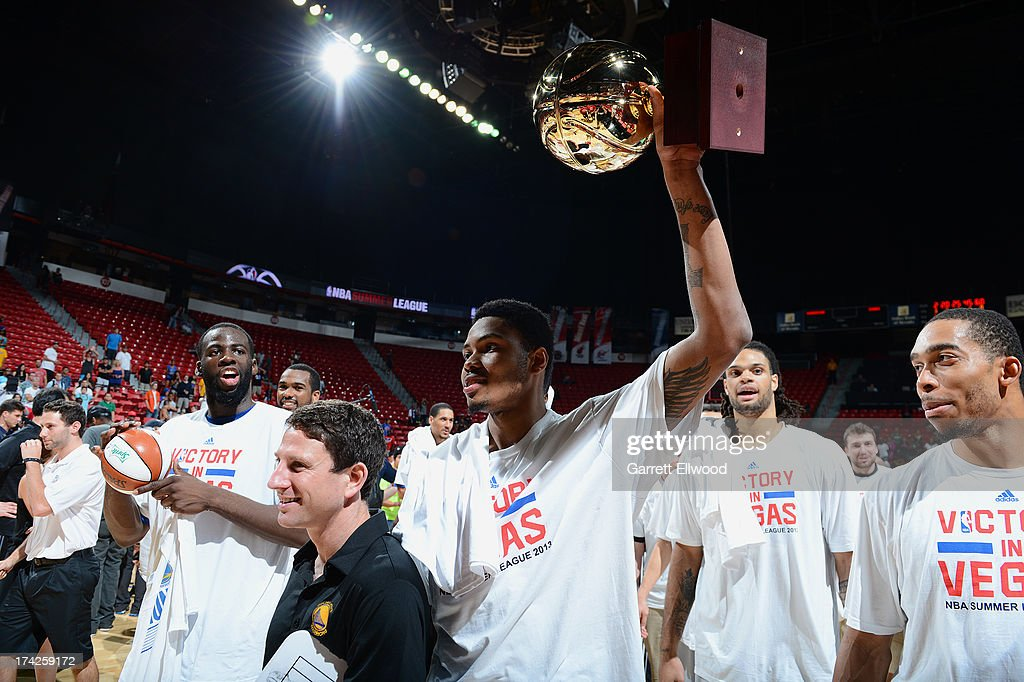 Members of the Golden State Warriors walk off the court holding their trophy after they beat the Phoenix Suns during NBA Summer League Championship Game on July 22, 2013 at the Cox Pavilion in Las Vegas, Nevada.