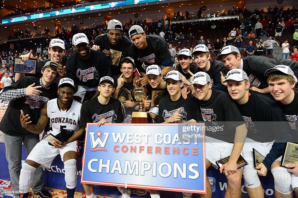 Members of the Gonzaga Bulldogs celebrate with the trophy after winning the championship game of the West Coast Conference Basketball tournament 75-64 over the Brigham Young Cougars at the Orleans Arena on March 11, 2014 in Las Vegas, Nevada.