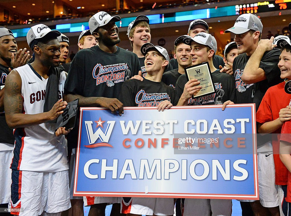 Members of the Gonzaga Bulldogs (L-R) Gary Bell Jr. #5, Sam Dower #35, David Stockton #11, Kevin Pangos #4 and Drew Barham #43 celebrate after winning the championship game of the West Coast Conference Basketball tournament 75-64 over the Brigham Young Cougars at the Orleans Arena on March 11, 2014 in Las Vegas, Nevada.