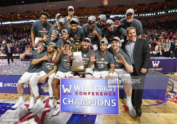 Members of the Gonzaga Bulldogs including head coach Mark Few celebrate with the trophy after defeating the Saint Mary's Gaels 7456 to win the...