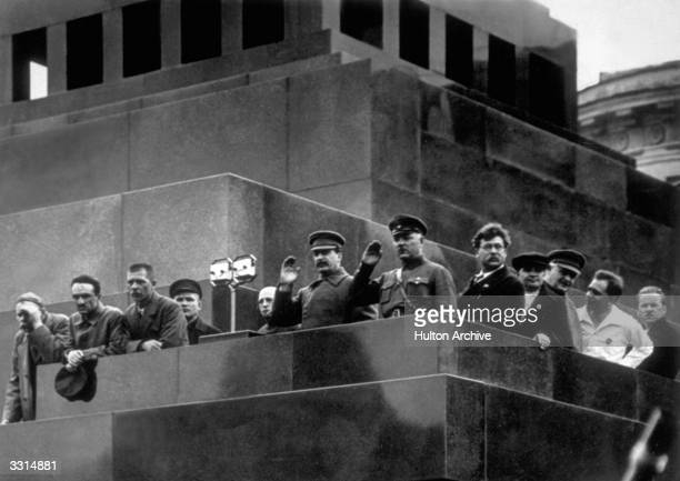 Members of the Government and Politburo during a parade of workers Left to right Gorky Boubnov Stalin Voroshilov and Jaroslavsky