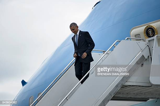 Members of the Governor General's foot guard are seen as US President Barack Obama arrives at Ottawa MacDonaldCartier International Airport for the...