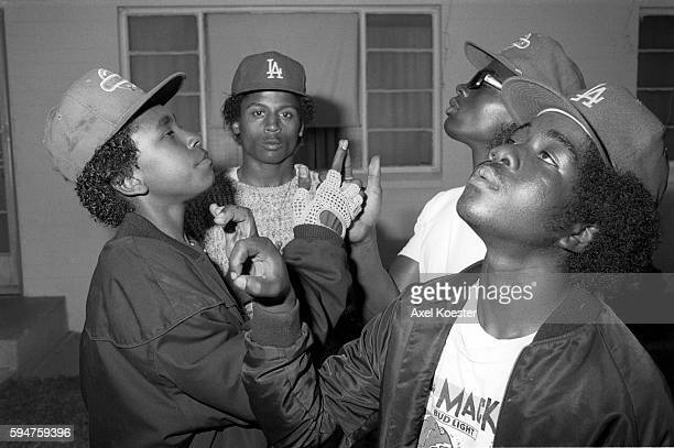Members of the Grape Street Crips pose 'throwing' their signature 'G' and 'W' hand signs The Grape Street Watts Crips are a mostly African American...