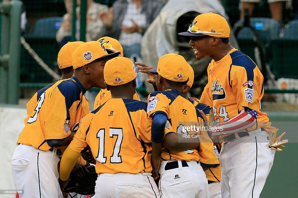 Members of the Great Lakes Team from Chicago, Illinois celebrate following their 7-5 win over the West Team from Las Vegas, Nevada during the United States Championship game of the Little League World Series at Lamade Stadium on August 23, 2014 in South Williamsport, Pennsylvania.