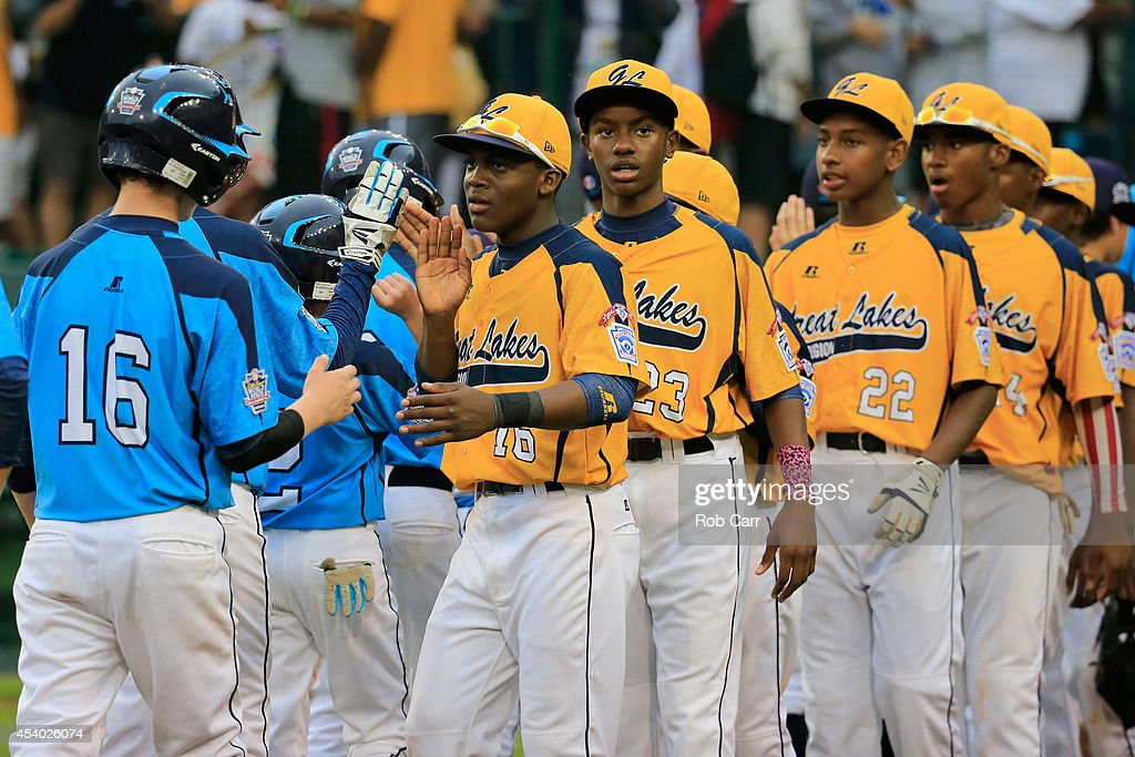 Members of the Great Lakes Team from Chicago, Illinois shake hands with members of the West Team from Las Vegas, Nevada following their 7-5 win during the United States Championship game of the Little League World Series at Lamade Stadium on August 23, 2014 in South Williamsport, Pennsylvania.