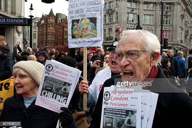 Members of the Greater London Pensioners Association join in the protest in support Disabled and able bodied demonstrators chain themselves together...
