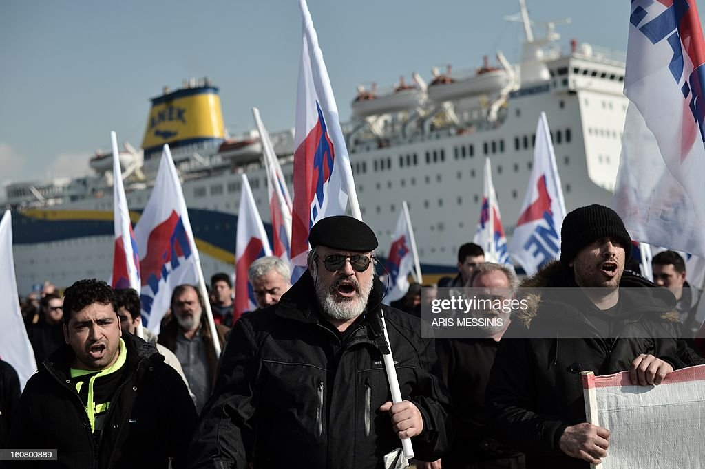 Members of the Greek comunist labour union demonstrate at the Greece's main harbour Piraeus port on February 6, 2013 in Athens during the forced end to a strike movement by seamen. Riot police were sent to Greece's main harbour Piraeus early on Wednesday to end a strike by seamen that has disrupted ferry services to the country's myriad islands for nearly a week, enforcing an emergency government order that took effect at 0400 GMT to force the strikers back to work.