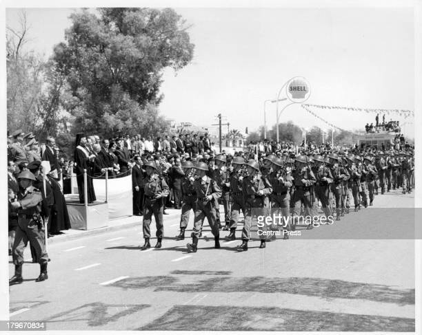 Members of the GreekCypriot Army parade past President Makarios during Eoka Day celebrations in NicosiaCyrus 1964