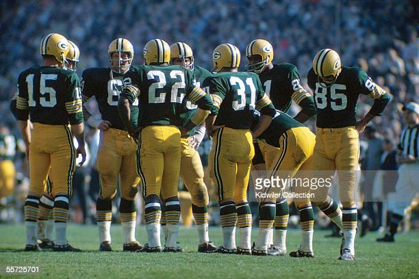 Members of the Green Bay Packers offense including Bart Starr Jerry Kramer Elijah Pitts Forrest Gregg Jim Taylor Marv Fleming and Max McGee huddle up...