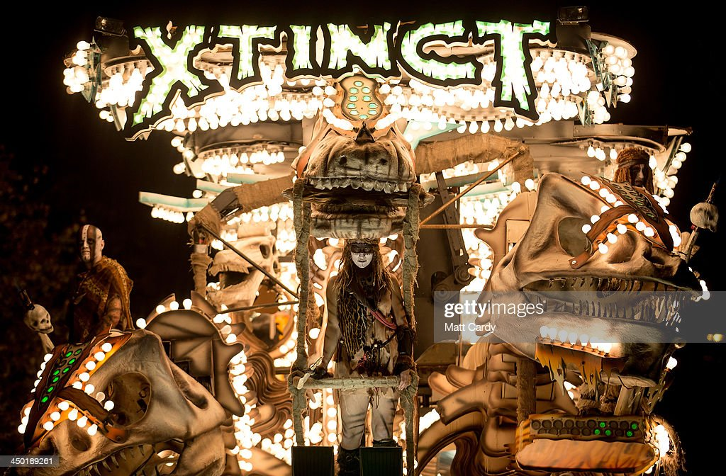 Members of the Gremlins Carnival Club stand on their illuminated cart, Xtinct, as they take part in the Glastonbury Carnival on November 16, 2013 in Glastonbury, England. Glastonbury Carnival, forms part of Somerset Carnival season and is one of a series of parades in towns throughout Somerset in November, widely regarded as one of the largest illuminated processions in the world. The major regional event, which can see crowds of up to 150,000 people at some towns and raises money for local charities, dates back to the Gunpowder Plot of 1605. Dedicated members of the numerous carnival clubs compete to design and build carts or 'floats' in secrecy from each other, using often thousands of GBP money they have raised throughout the year and compete for prizes that are awarded in several categories for the best carts in each carnival. The numerous carts - gathered from all over the county - measure up to 30metres long, often featuring state-of-the-art electronics and hydraulics, crewed by club members in costume and are decorated with tens of thousands of light bulbs. This year, the Carnival season, which started at Bridgwater, before going onto Weston-super-Mare, Burnham-on-Sea, North Petherton, Shepton Mallet and Wells, ended in Glastonbury.