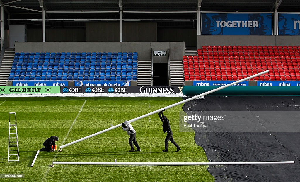 Members of the ground staff lift the goal posts into postion before the LV= Cup match between Sale Sharks and Scarlets at Salford City Stadium on January 26, 2013 in Salford, England.
