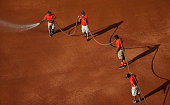 Members of the grounds crew water the infield during the game between the Chicago White Sox and the Houston Astros at Minute Maid Park on May 17 2014...
