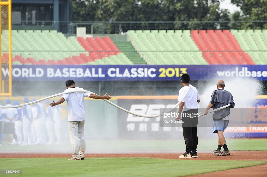 Members of the grounds crew work on the field before the World Baseball Classic workout day of Team Korea at Taichung Intercontinental Baseball Stadium on Friday, March 1, 2013 in Taichung, Taiwan.