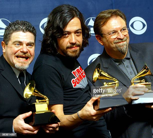 AWARDS –– Members of the group Cafe Tacuba left to right Gustavo Santaolalla Meme center and Anibal Kerpel pose with their Grammy for Best Latin...