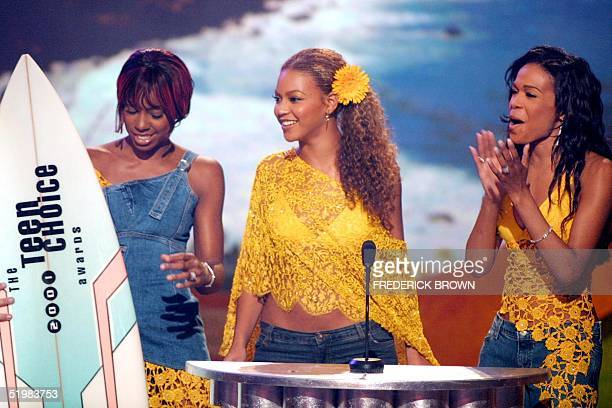 Members of the group Destiny's Child accept their award for Choice Pop Group during the taping of the Teen Choice 2001 Awards at the Universal...
