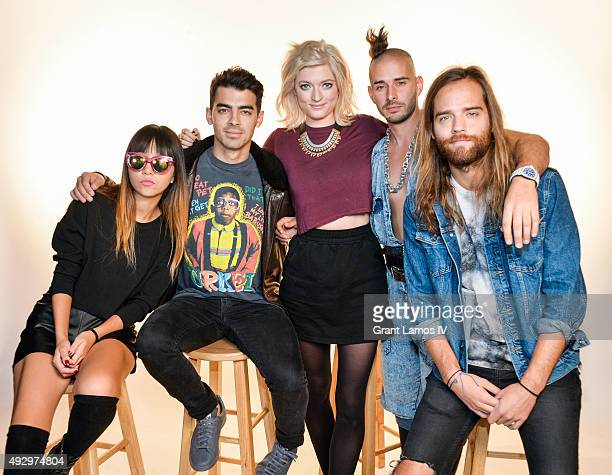Members of the group DNCE JinJoo Lee Joe Jonas Cole Whittle and Jack Lawless pose with Music Choice Countdown Host Sophie Sumner at Music Choice on...