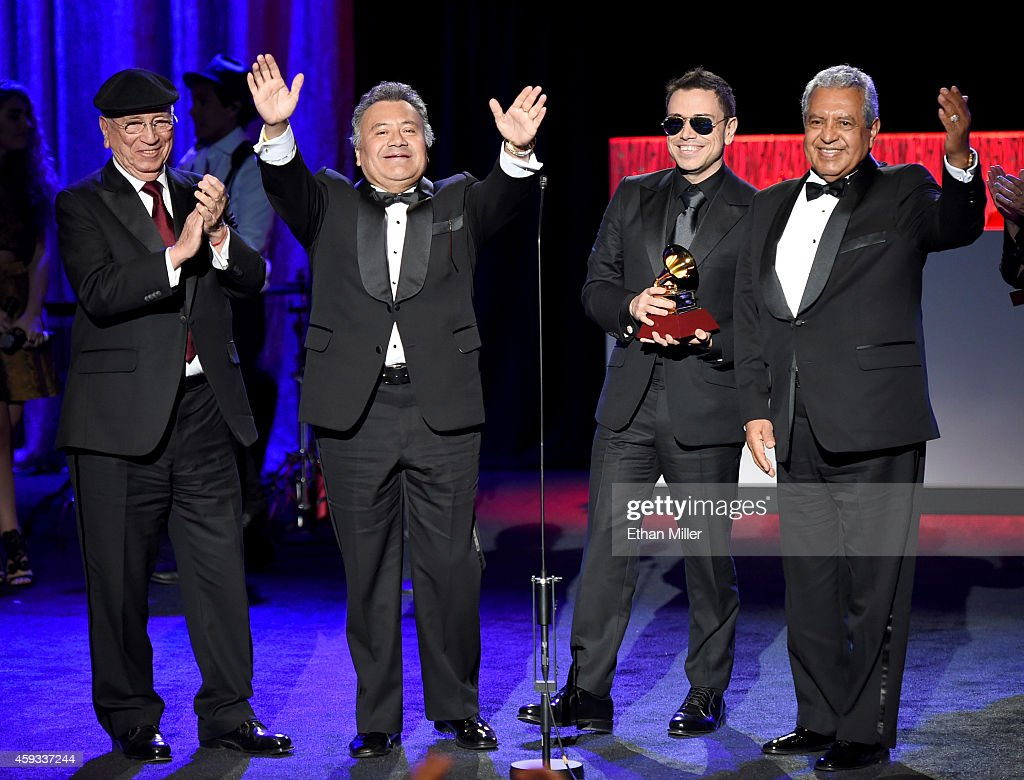 Members of the group La Sonora Santanera accept the award for Best Traditional Tropical Album during the 15th annual Latin GRAMMY Awards premiere ceremony at the Hollywood Theatre at the MGM Grand Hotel/Casino on November 20, 2014 in Las Vegas, Nevada.