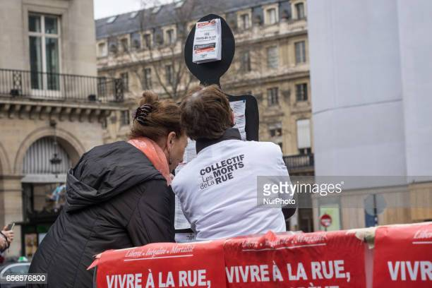 Members of the group 'les Morts de la Rue' on the Place du Palais Royal in Paris on March 21 in memory of 501 homeless people who died in 2016 in...