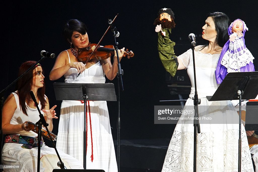Members of the group 'Marcela Perez Silva y su grupo' from Peru work a puppet symbolizing guerrilla fighter Ernesto Che Guevara (C) during a concert of international artists on the eve of the 85th birthday of Cuba's Revolution leader Fidel Castro in the Teatro Karl Marx August 12, 2011 in Havana, Cuba. The three hour 'Serenade for Fidelity' (Serenata a la Fidelidad) was organized by the Foundation Guayasemin from Ecuador and the Cuba Ministry of Culture. Fidel Castro fell ill in July 2006 and has stepped back from power, handing over power to his younger brother Raul Castro.