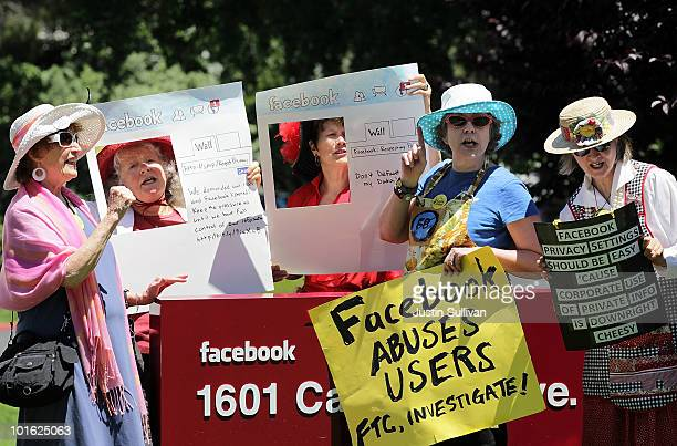 Members of the group Raging Grannies stage a demonstration outside of the FaceBook headquarters June 4 2010 in Palo Alto California The group was...