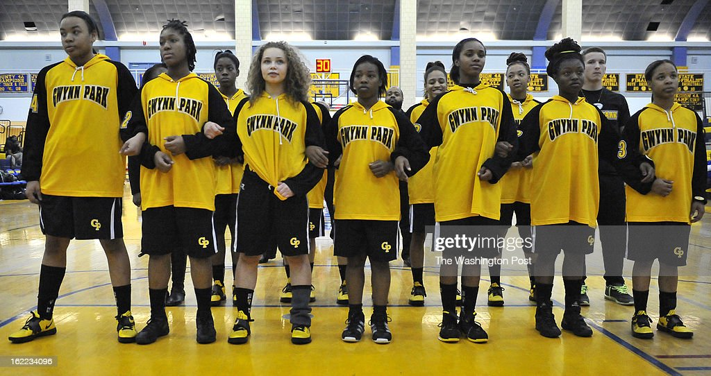 Members of the Gwynn Park team linked arms during the playing of the national anthem at the start of the Prince George's County championship game at Wise high school on Wednesday, February 20, 2013 in Upper Marlboro, Md.