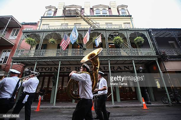 Members of the Hacienda Brass Band march while performing for a bachelor party in the famed French Quarter a magnet for tourists on August 21 2015 in...