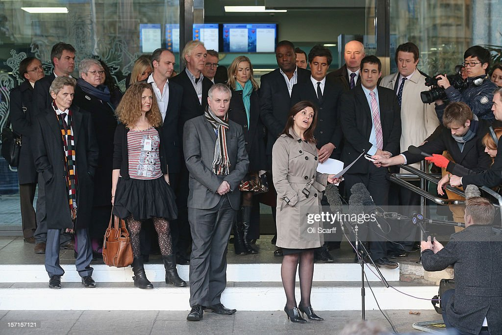 Members of the 'Hacked Off' campaign group address the media outside the Queen Elizabeth II conference centre following the publishing of the Leveson...
