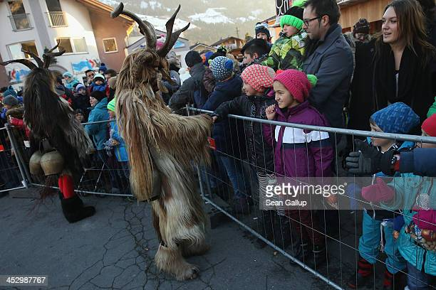 Members of the Haiminger Krampusgruppe dressed as the Krampus creature approach onlookers prior to the annual Krampus night in Tyrol on December 1...