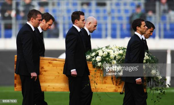 Members of the Hannover 96 football club carry the coffin of their goalie Robert Enke at a memorial service prior to Enke�s funeral at AWD Arena on...